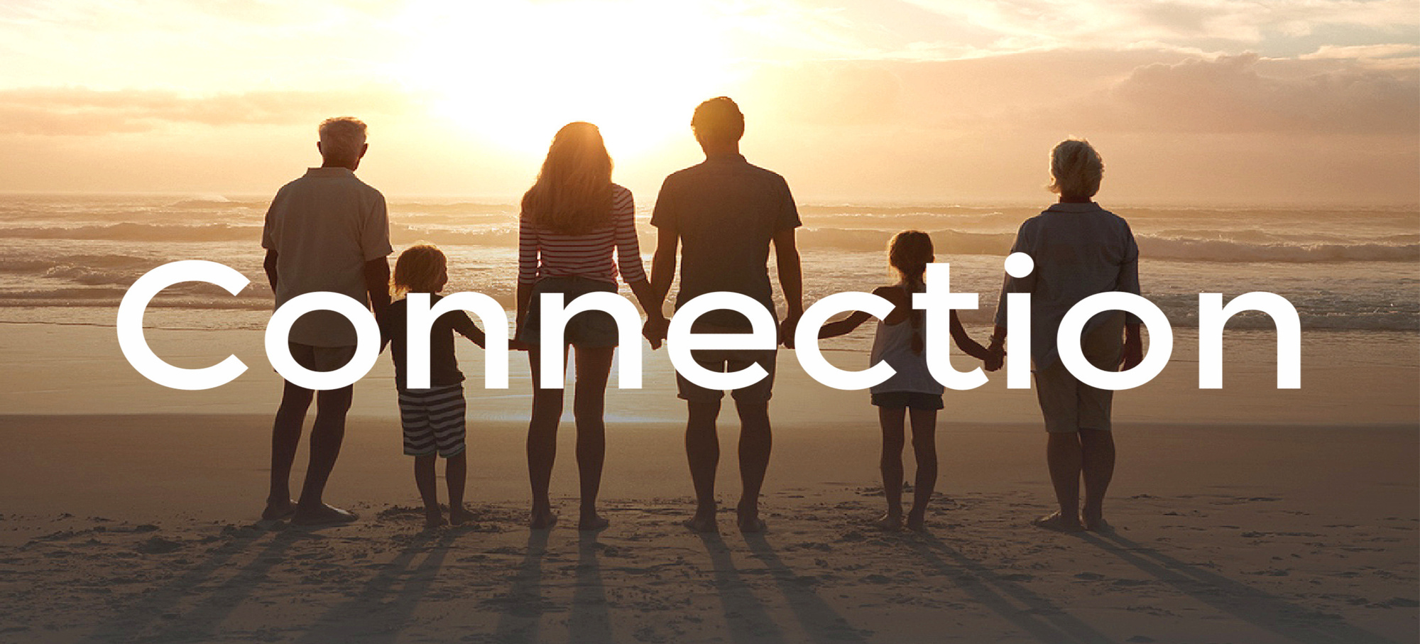 Connection banner with family standing on beach at the sunset
